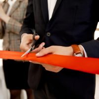 front-view-cutting-red-ribbon-grand-opening-building_8353-10570
